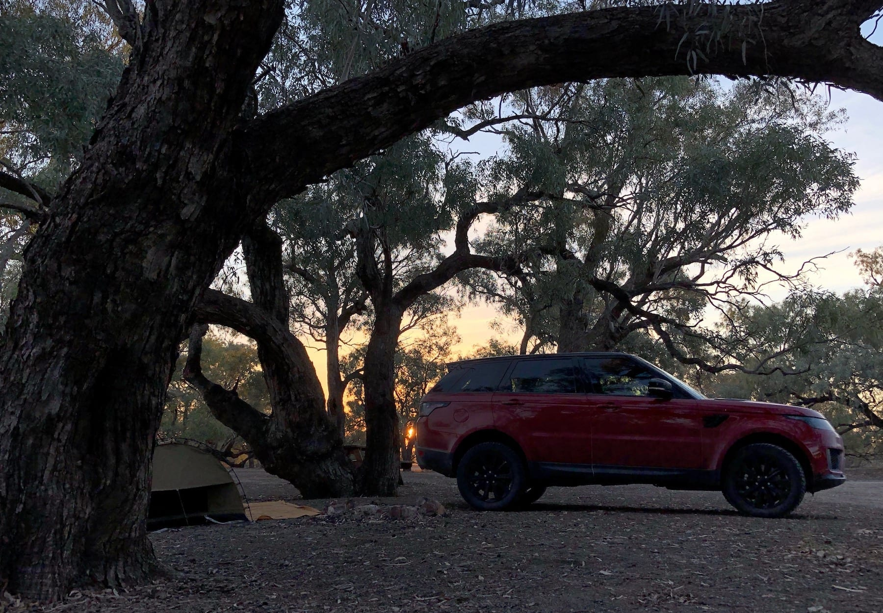 Range Rover Sport and swag at sunset on the Darling River.