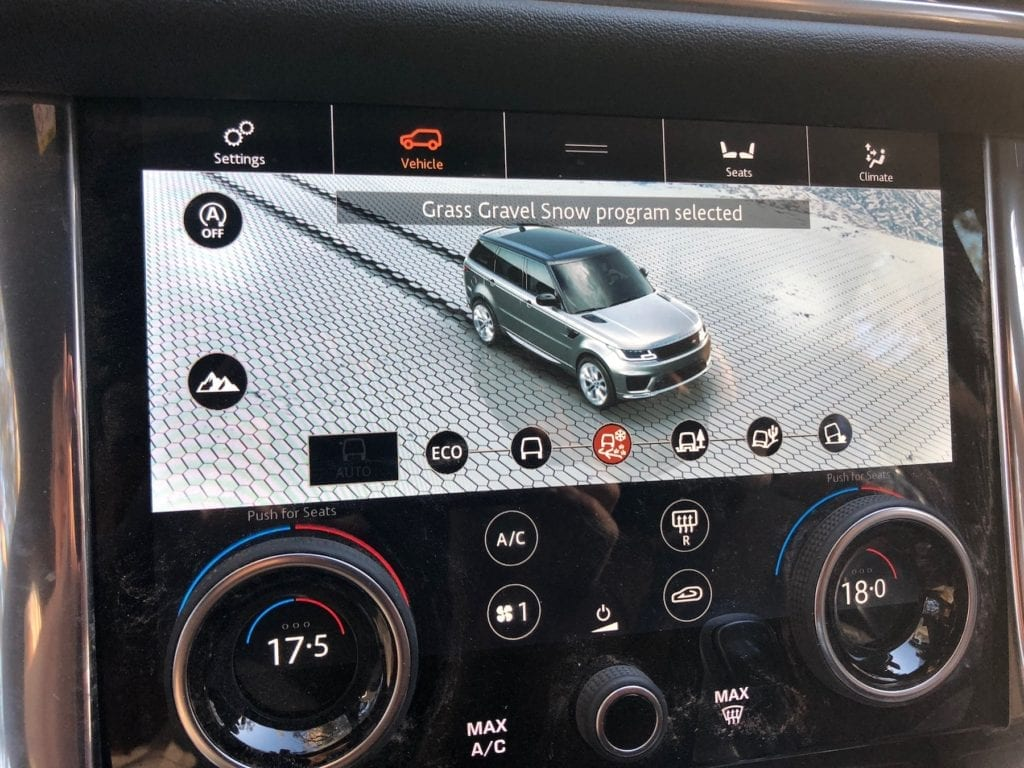 Selecting the correct mode on the in-dash display of the Range Rover Sport.