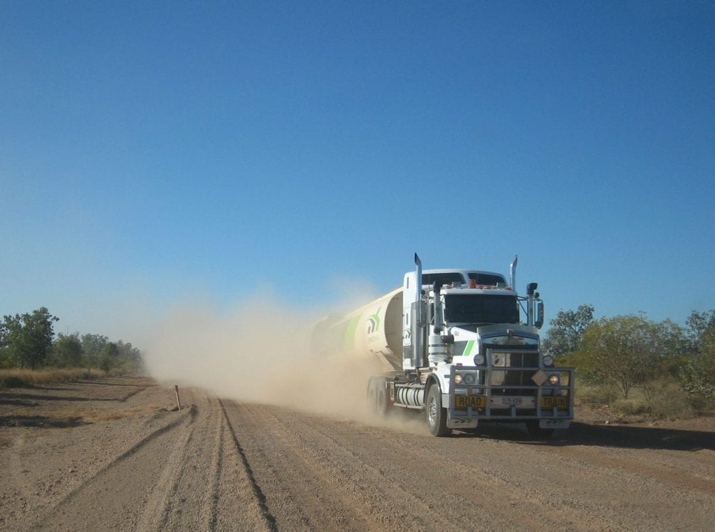 Roadtrains kick up plenty of duct on dirt roads. Pull off and let the dust settle. Road safety.