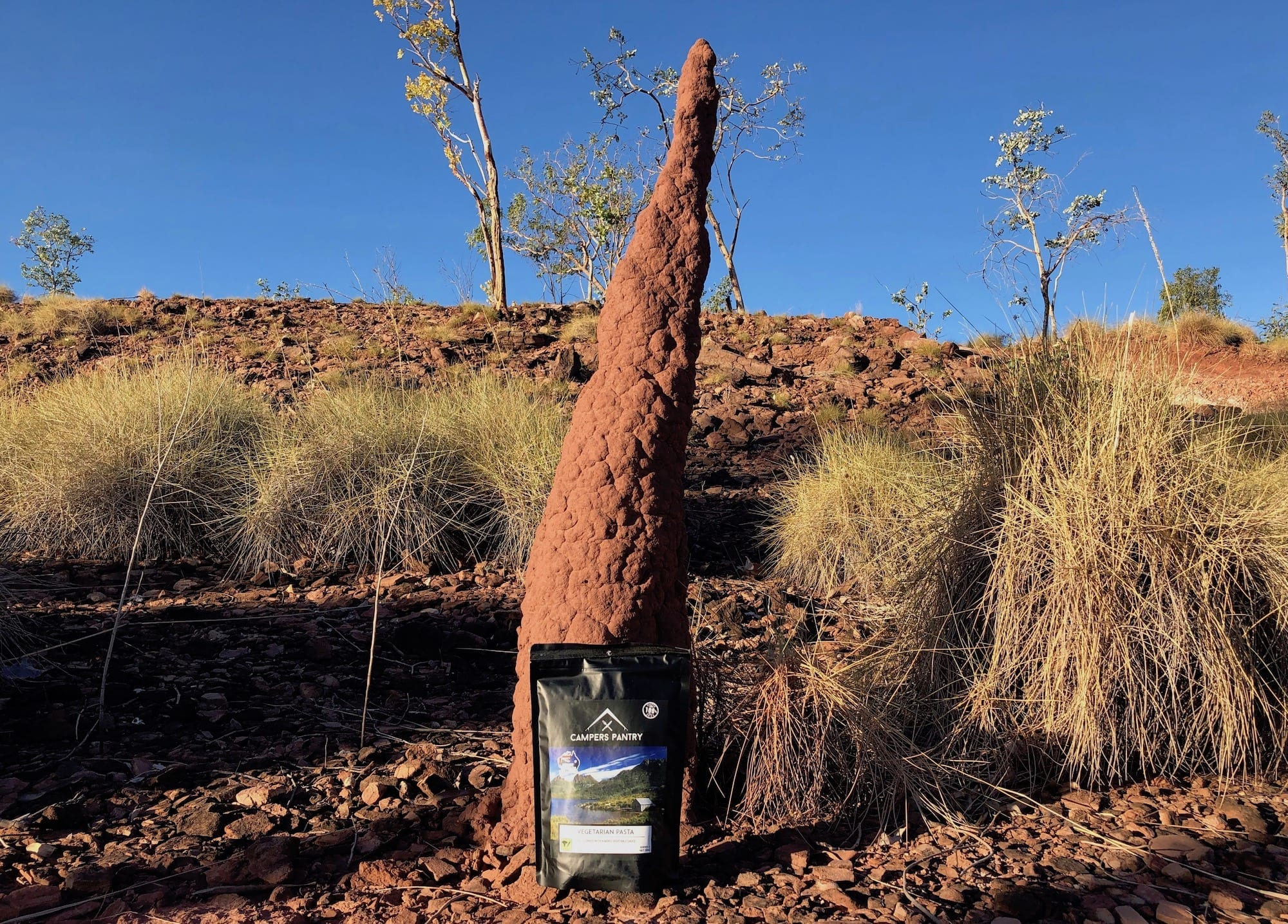 Vegetarian Pasta from Campers Pantry in front of a termite mound in Judbarra / Gragory National Park, NT.