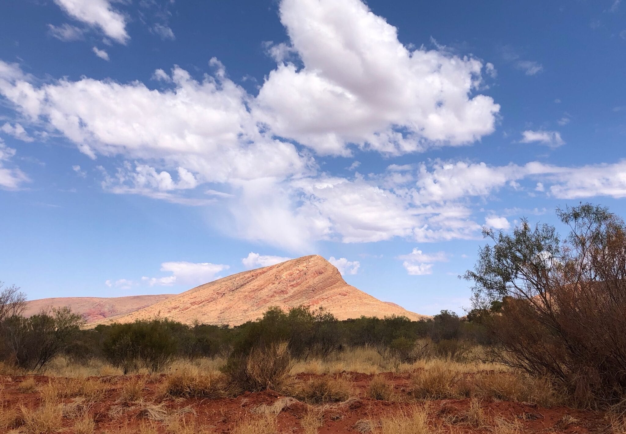 An unusual mountain of solid rock, Peterman Ranges. Great Central Road, Great Victoria Desert.