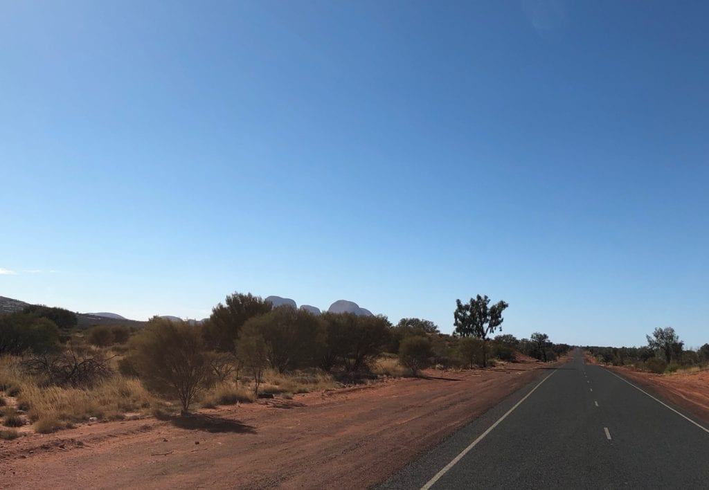 Kata Tjuta rising out of the desert. Great Central Road, Great Victoria Desert.