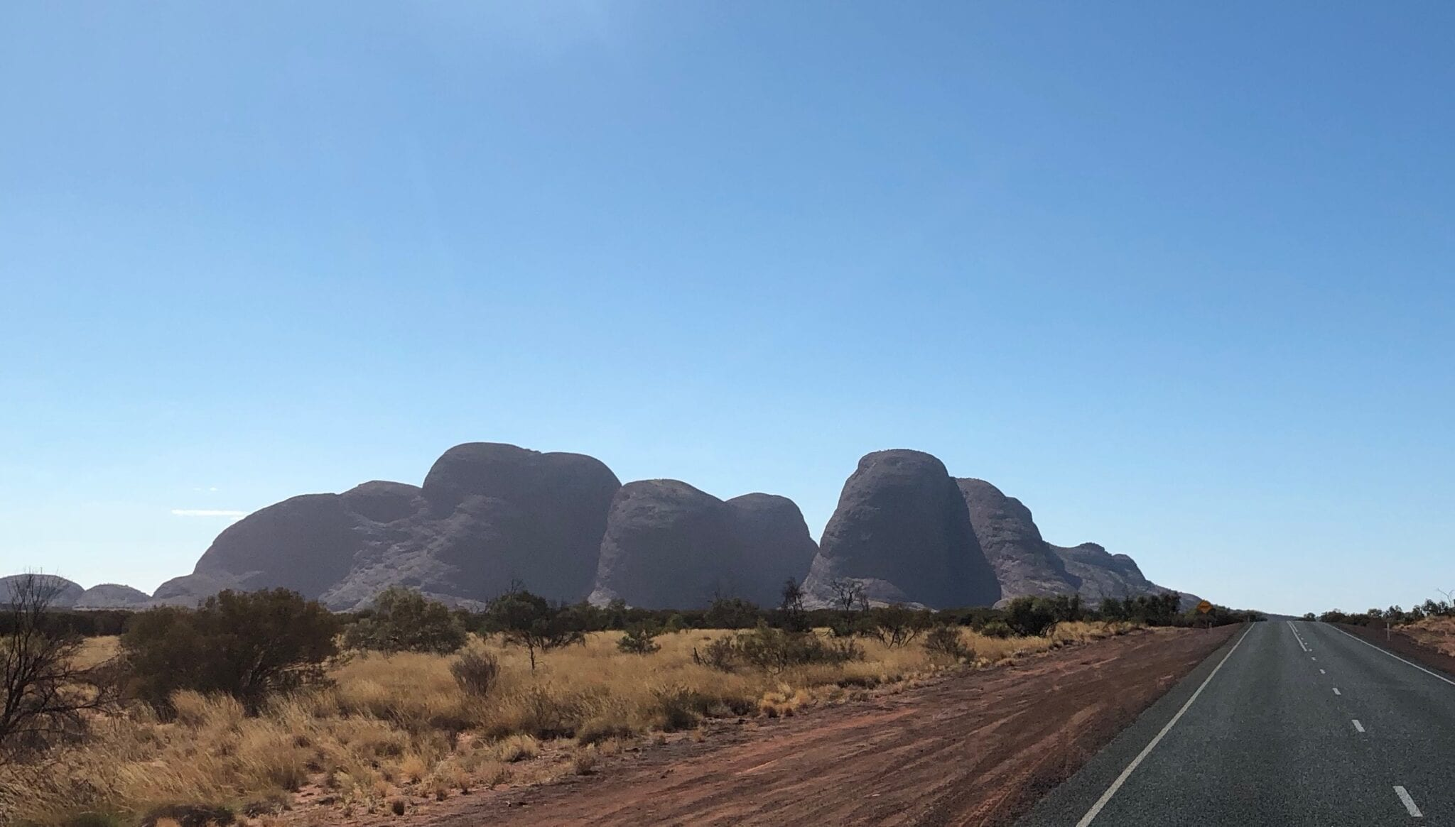 The mysterious domes of Kata Tjuta taking shape as we drive east along the Great Central Road.