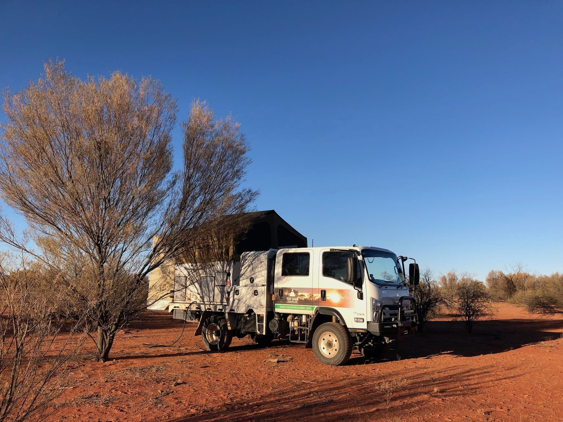 Our 4x4 truck camper, set up on the side of Bulloo Downs Road QLD.