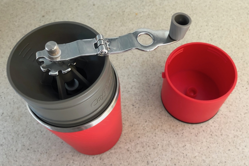 The grinder handle unfolds. Cafflano Klassic, camping coffee maker.