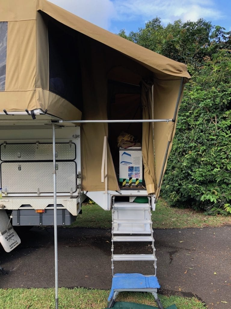 Wedgetail Camper brace pole runs horizontally above the steps. We added this to support the awning over the stairs. It was bending in during strong winds.