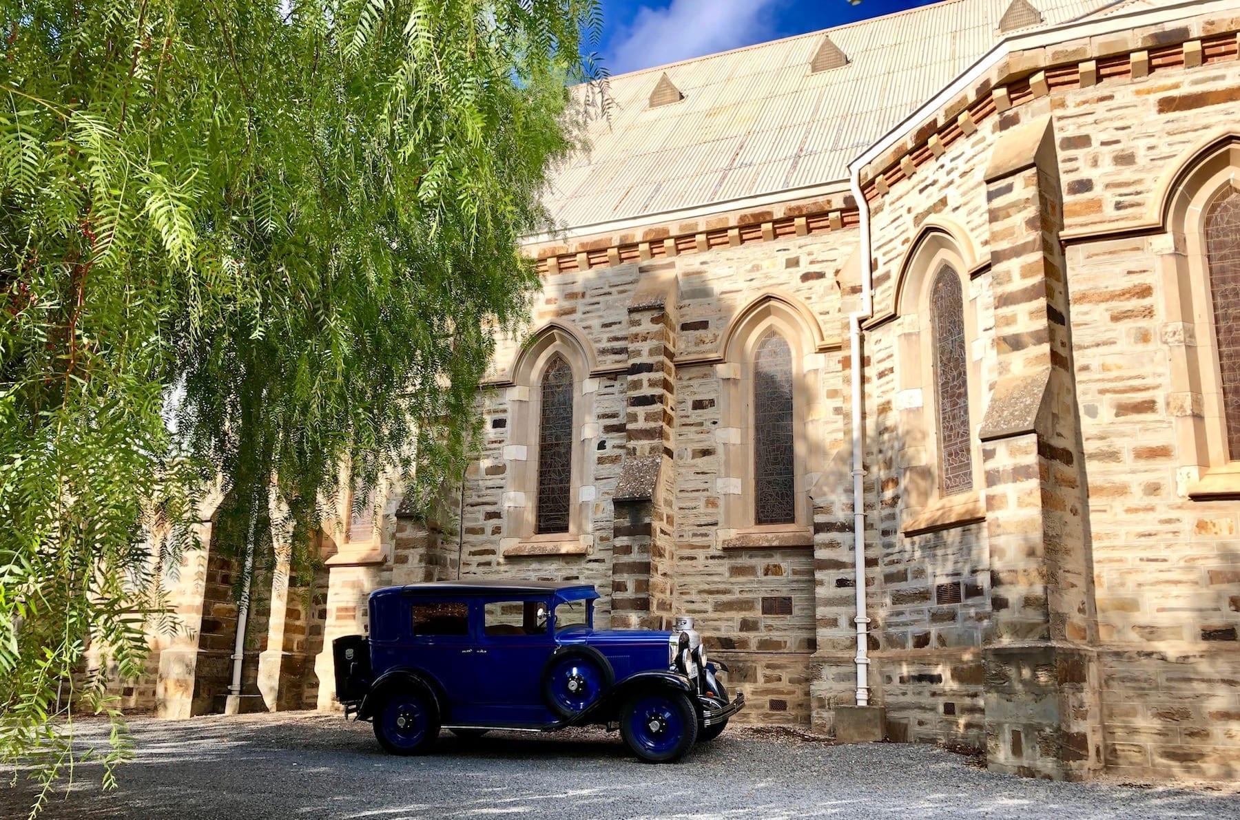 A vintage car outside the catholic church in Burra South Australia.