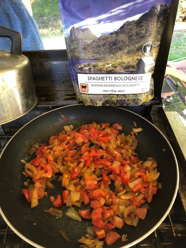 Easy camping meals. Spaghetti Bolgonese from Campers Pantry. We added onions, tomatoes and chillis.