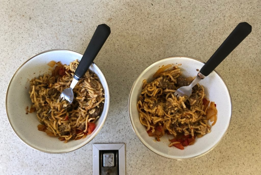 Easy camping meals from Campers Pantry. Spaghetti Bolognese after we added cooked onion, tomatoes and chillis.