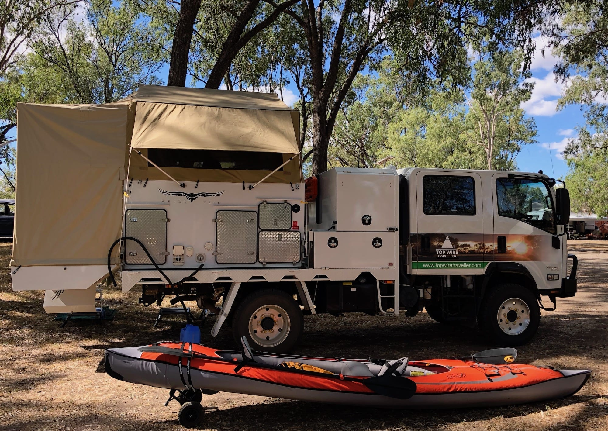 Our slide on camper mounted on the back of our truck.