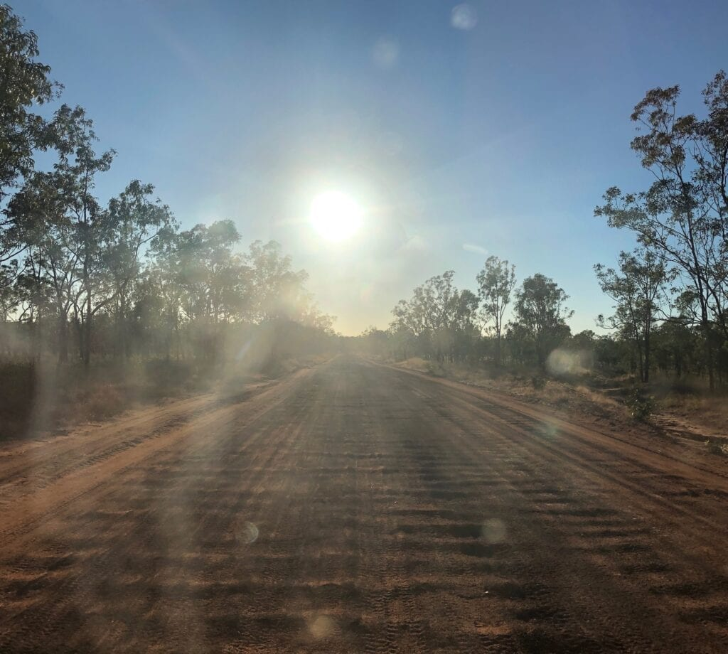 Driving east into the blinding sun, east of Borroloola NT.