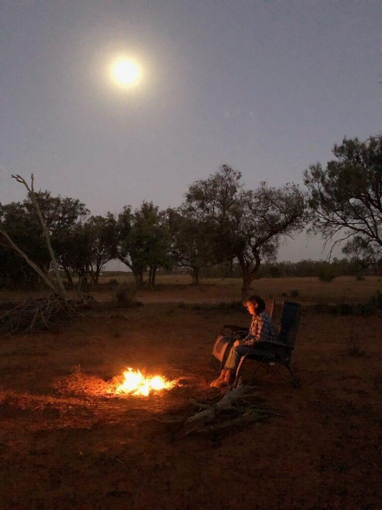 A campfire under a full moon at the Sunraysia Safari.