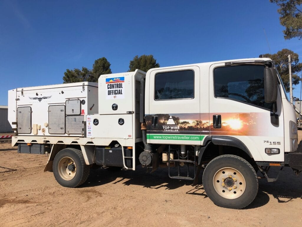 Our truck camper covered in stickers for the Sunraysia Safari.