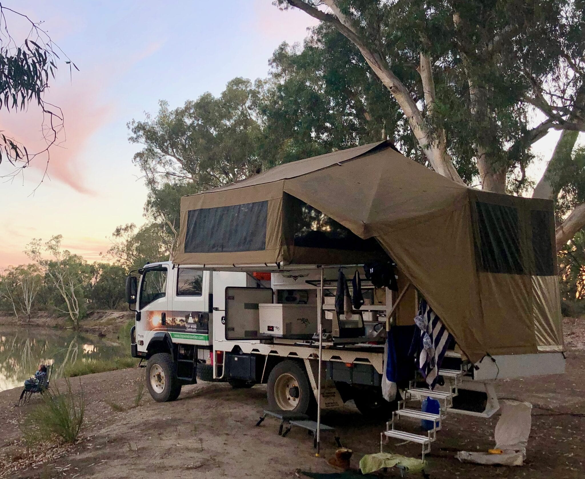Wedgetail Camper mounted on an Isuzu NPS light truck. Camped on the Murray River in South Australia.