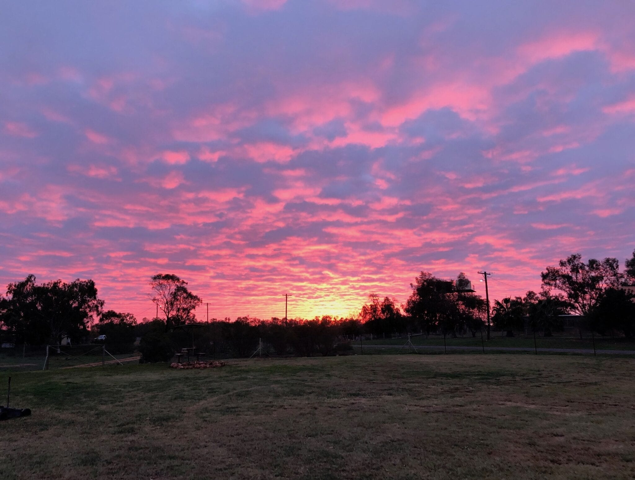 An incredible pink sunset at Wanaaring, NSW. The Cut Line, NSW.