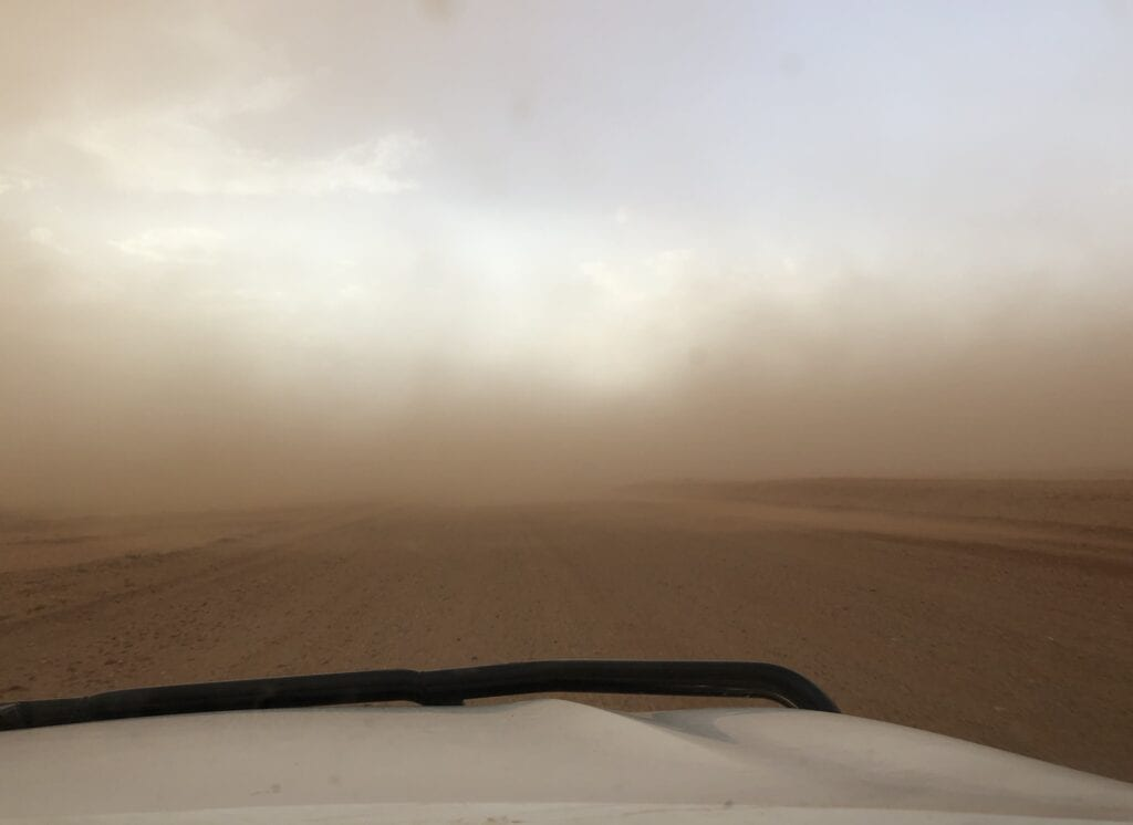 Driving along the Tibooburra to Cameron Corner Road, straight into a dust storm.
