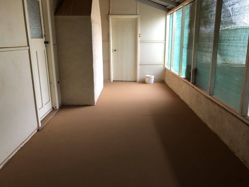 The verandah floor of Fort Grey homestead was covered in a uniform layer of dust and sand after the dust storm. Fort Grey, Sturt National Park.