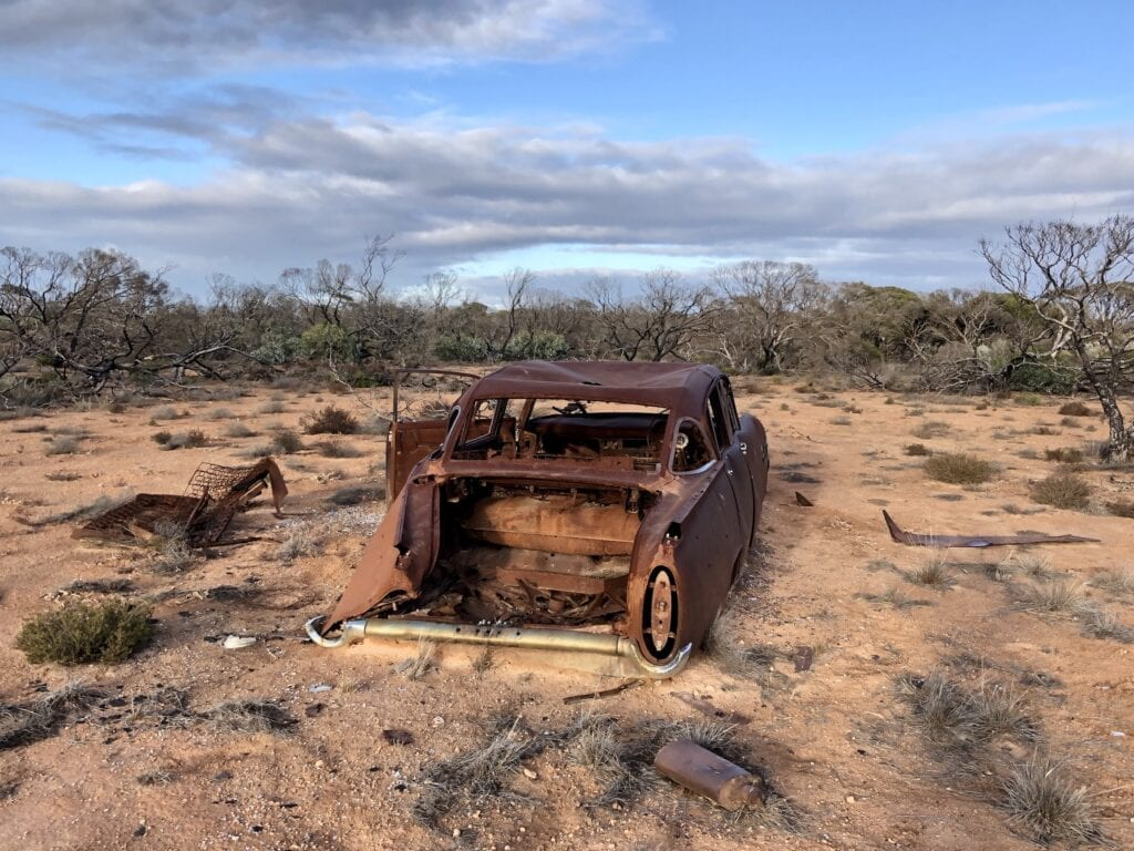 A 1950's American car that has obviously rolled. Old Eyrte Highway, Nullarbor Plain SA.