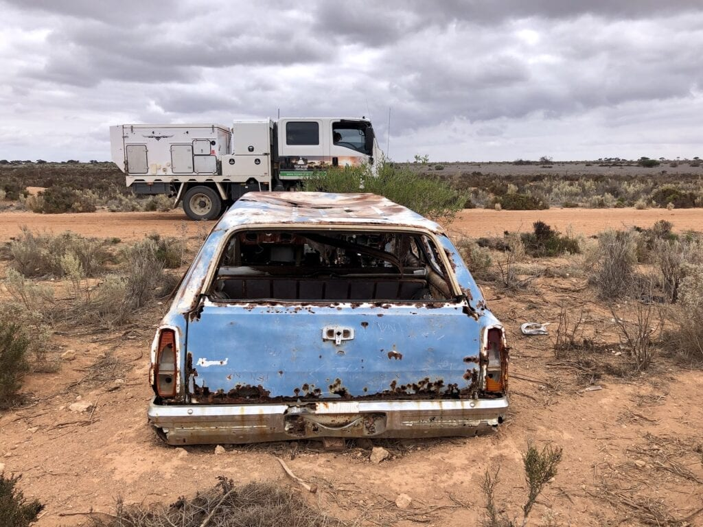 Wreck of a HQ Holden beside the Old Eyre Highway. Nullarbor Plain, SA.