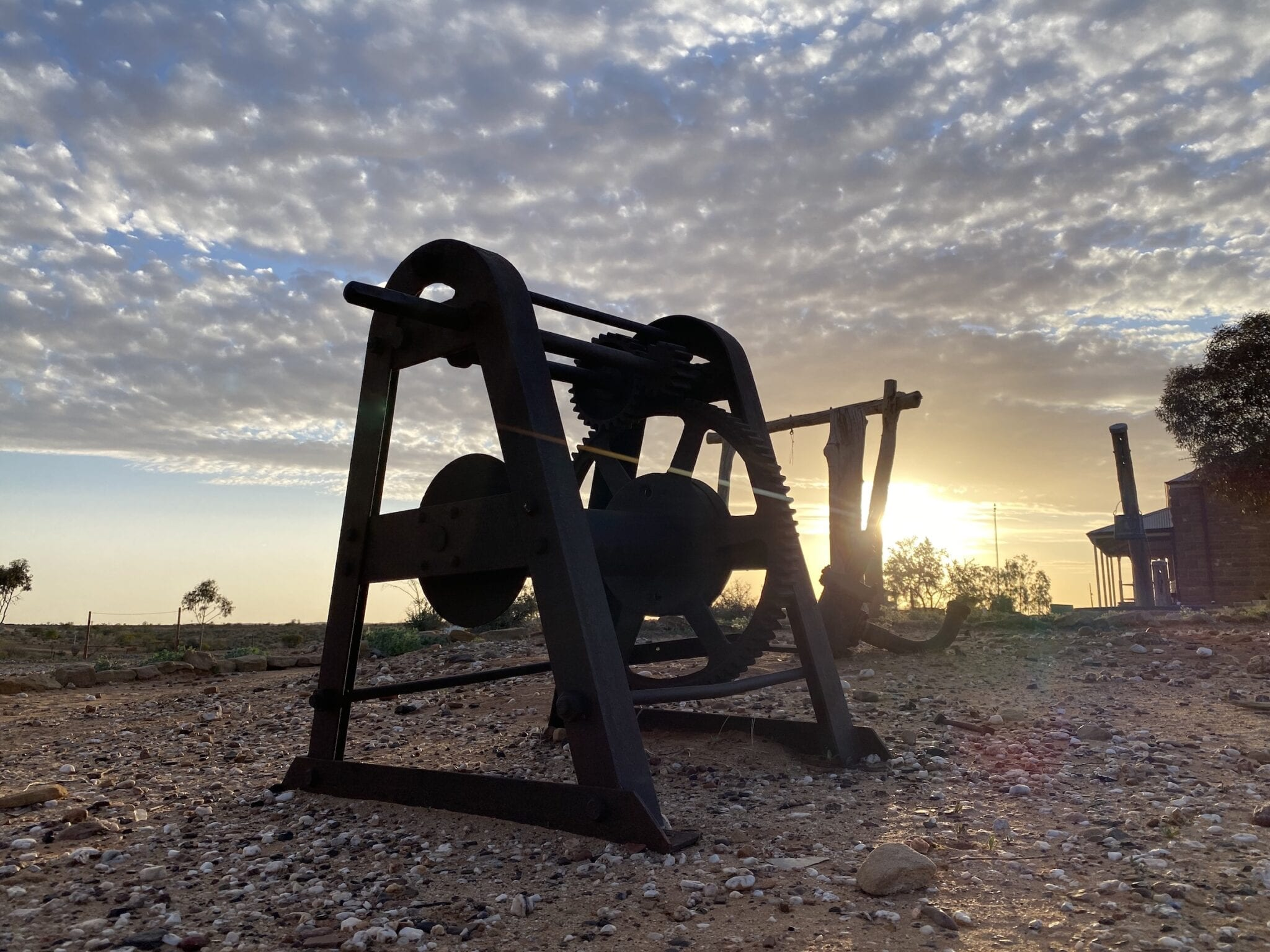 An old hand winch silhouetted by the afternoon sun. Milparinka NSW.
