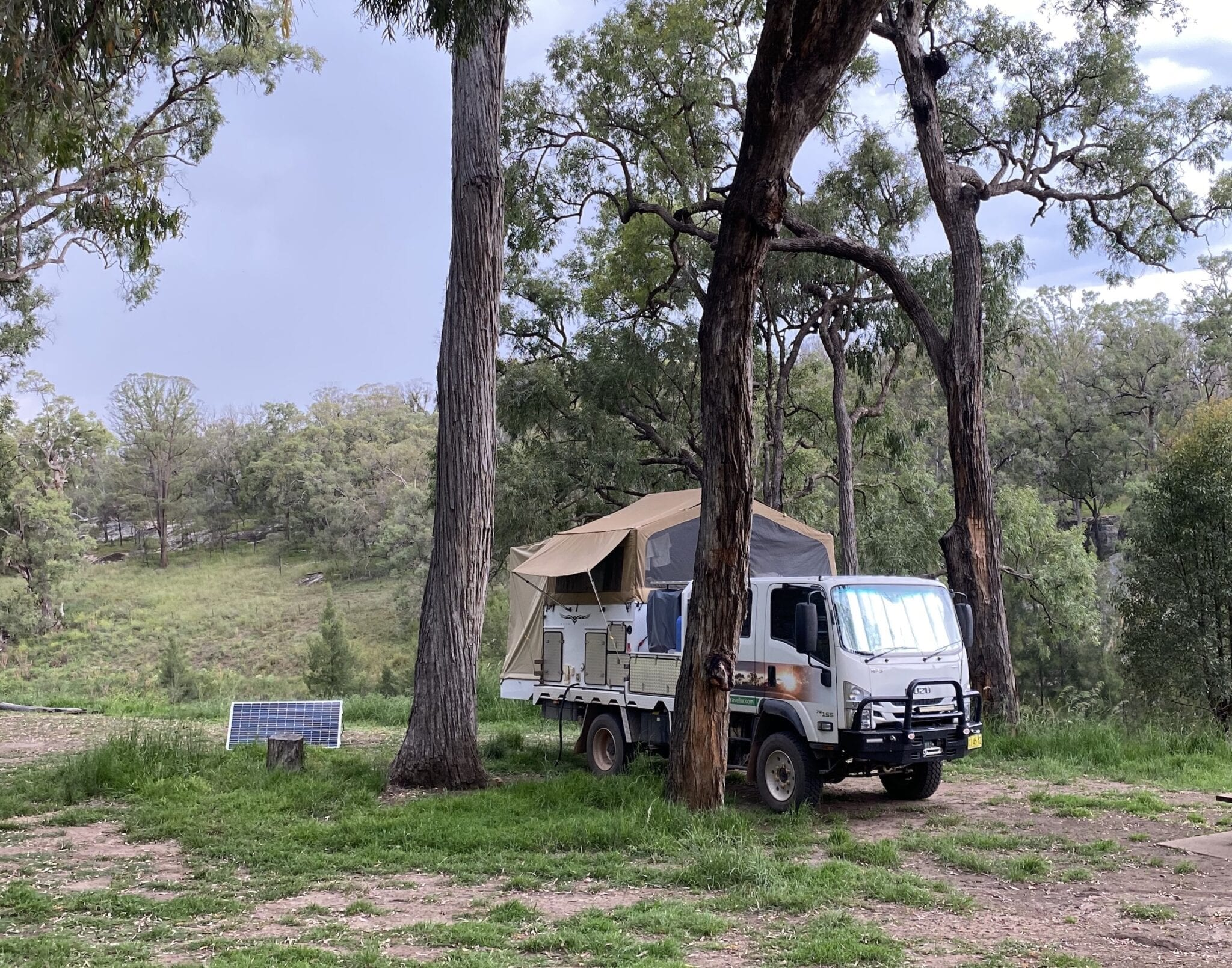 Wedgetail slide on camper and Isuzu 4WD truck camped at Goulburn River National Park.