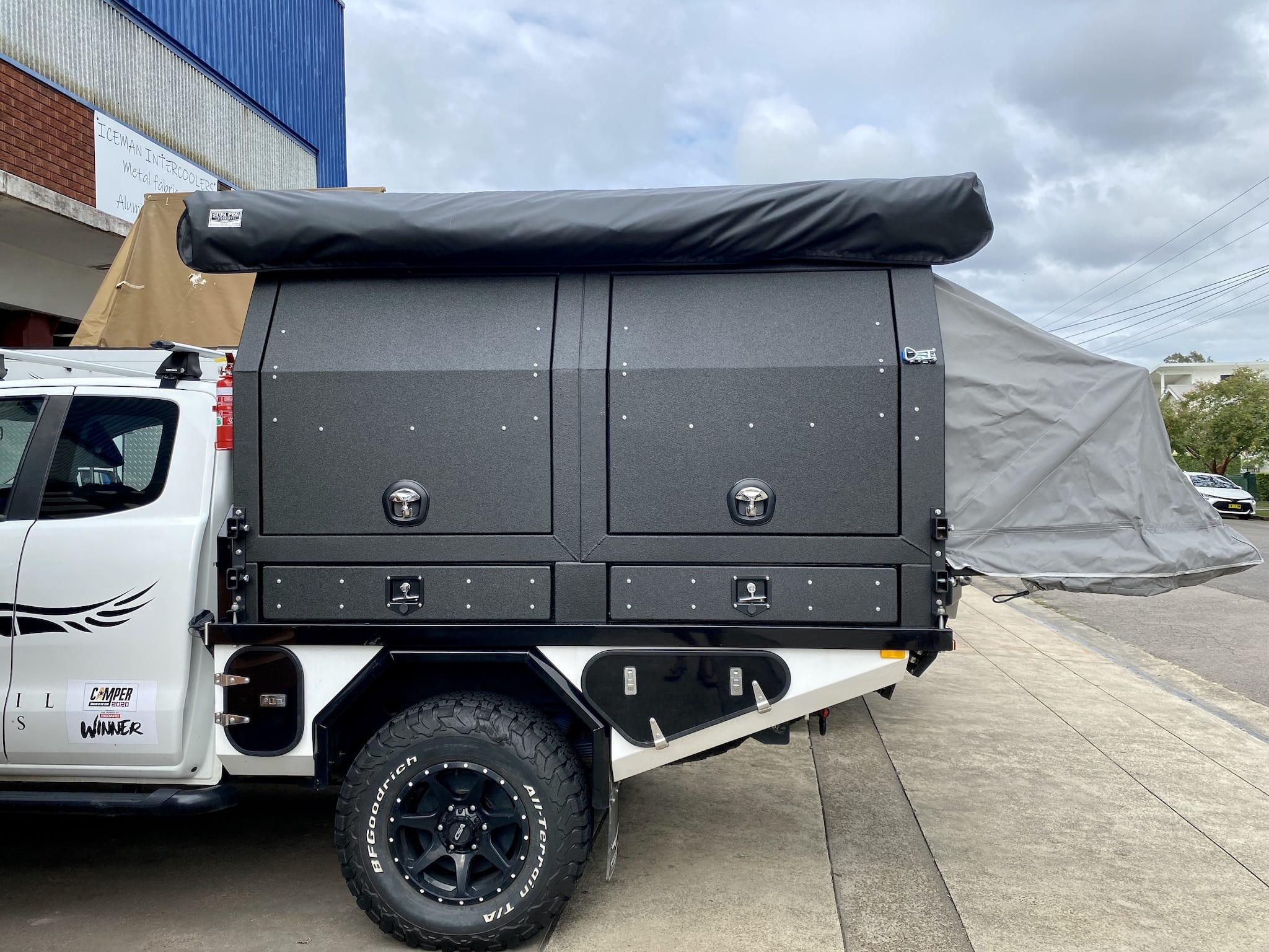 The Wedgetail Hawk ute canopy camper viewed from the passenger side.