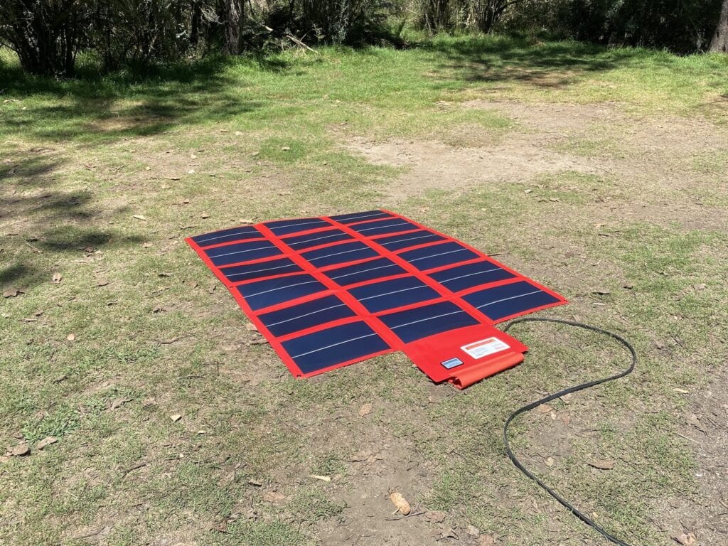 REDARC 112W amorphous solar blanket opened out, flat on the ground.