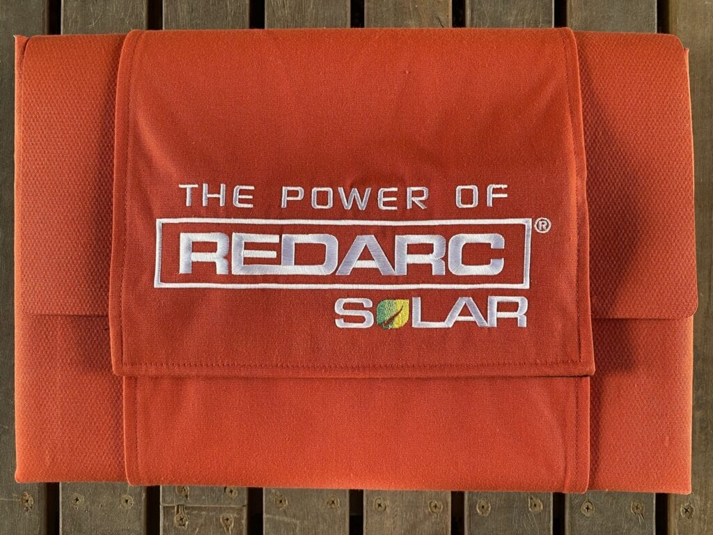 REDARC's solar blankets fold into a neat bundle, with a wraparound flap to secure the blanket.
