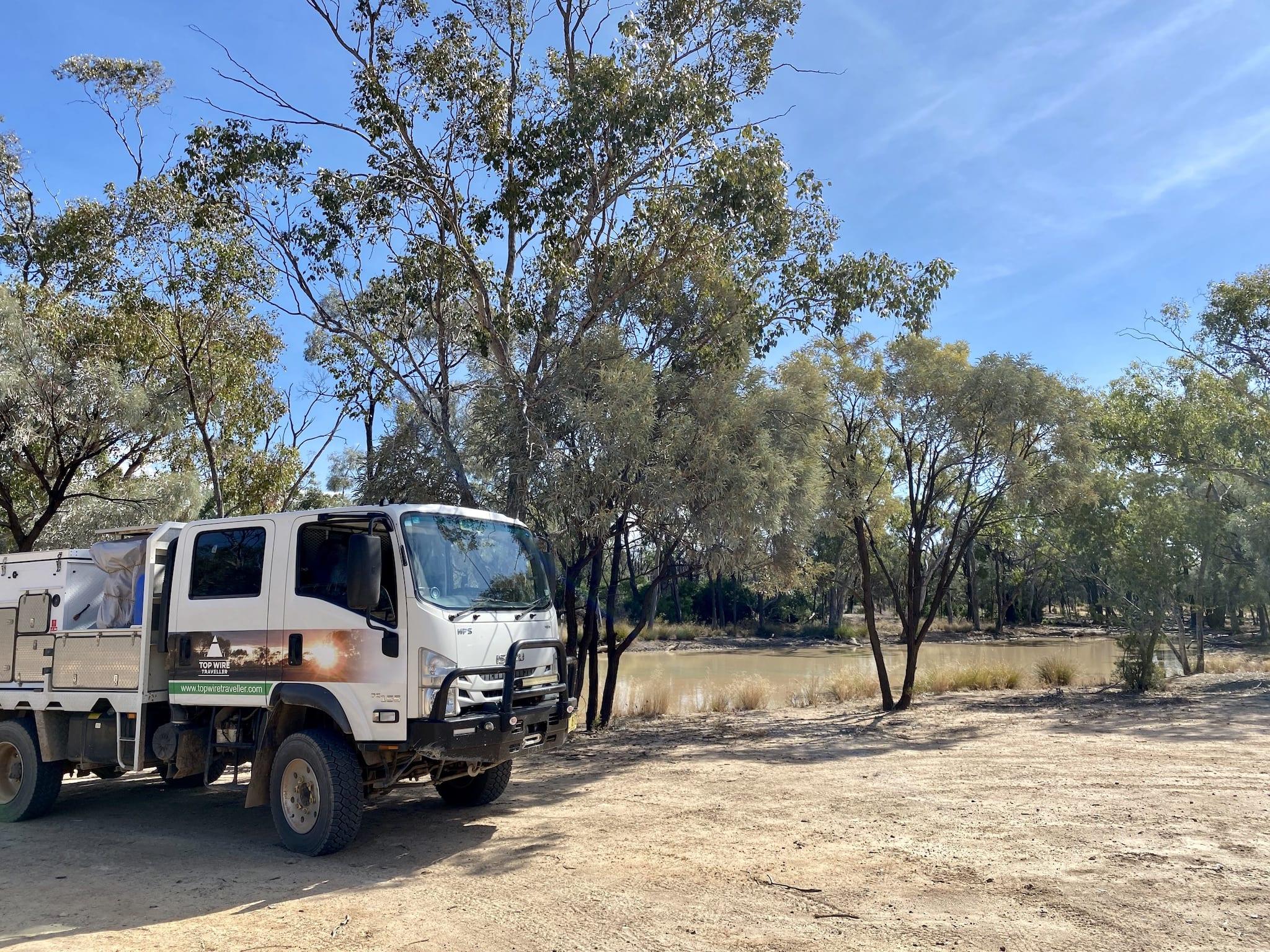 Our Isuzu truck camper parked at Junction Waterhole, Idalia National Park QLD.