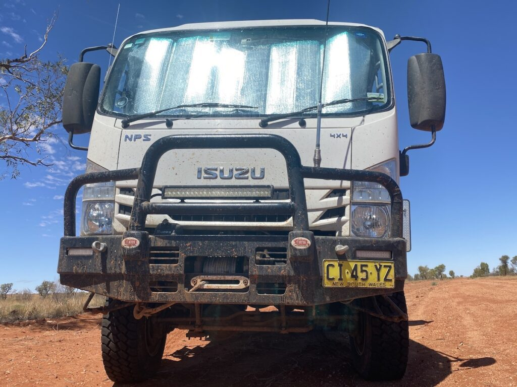 Muddy Isuzu NPS 4WD truck at the Dig Tree in south-western Queensland.