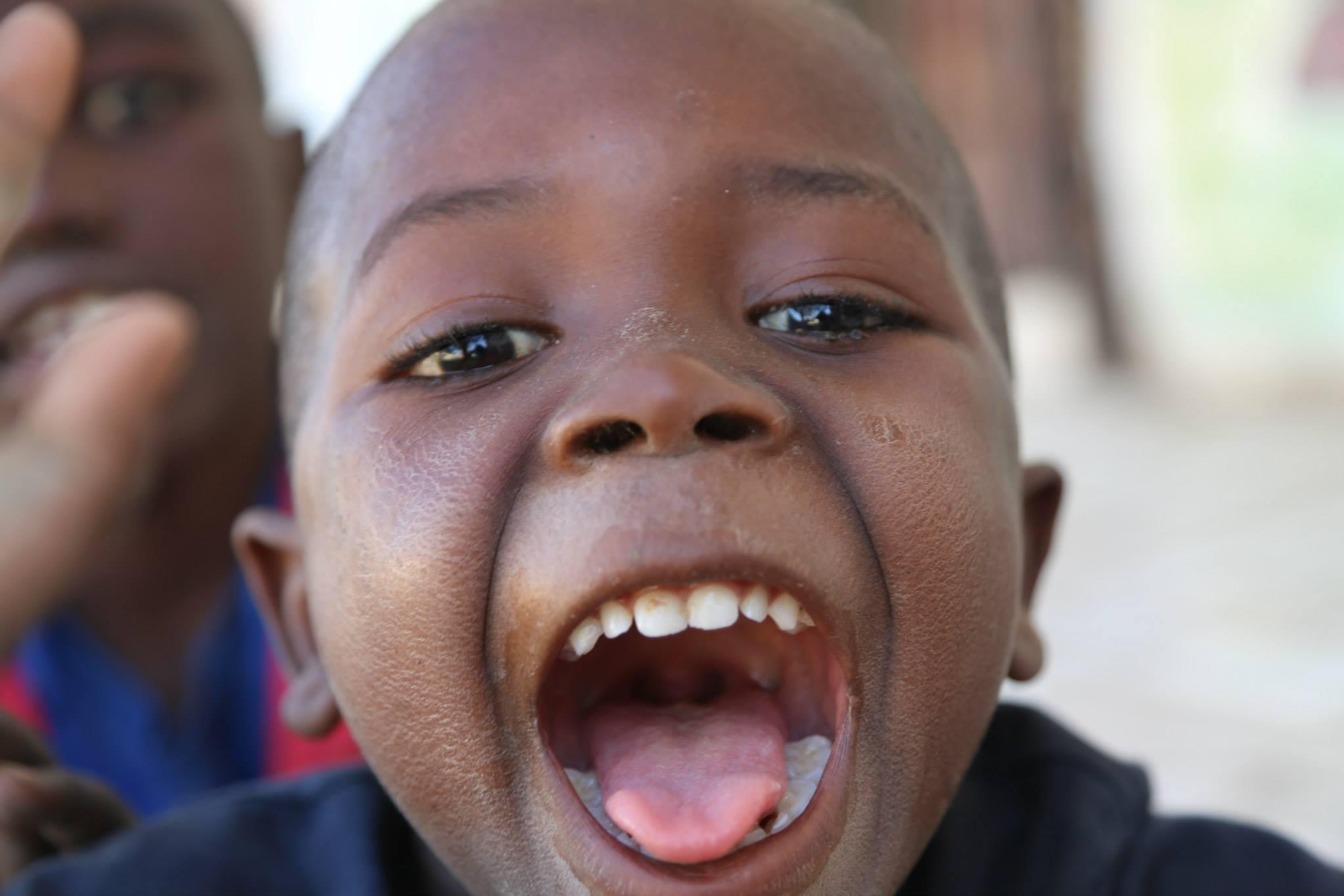 black boy, zambian boy, boy in zambia, mouth open, mouth agape, toy box studios, zambia 2018