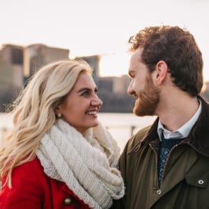 Man and woman looking into each others eyes and smiling