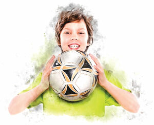 Child holding a soccer ball