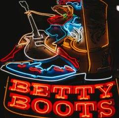 turned-on Betty Boots neon signage at night