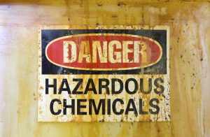 Danger Hazardous Chemicals Sign on a stained storage barrelA related image from my portfolio: