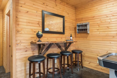 Basement rec room - custom bar by local craftsman