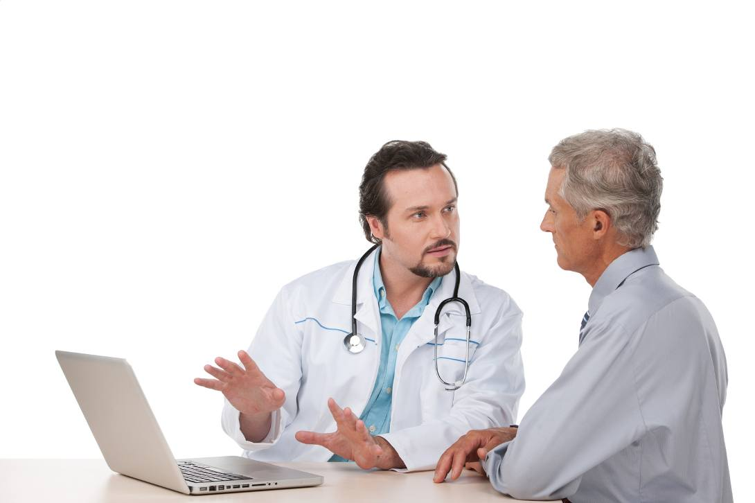 Doctor with laptop explaining to a senior patient