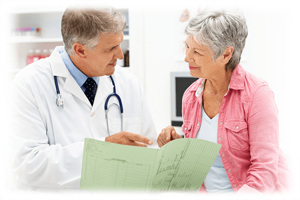 Doctor explaining treatment options to senior-aged patient