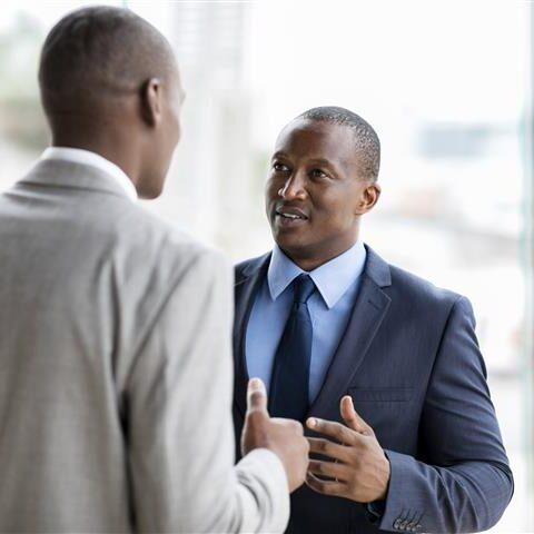 Businessmen having conversation in office