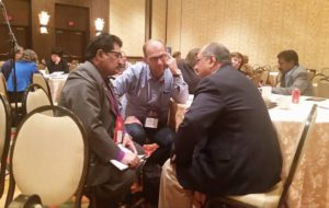 Committee members discuss faith sharing.