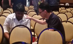 A moment of prayer between Wesleyan Methodists from India and Australia.