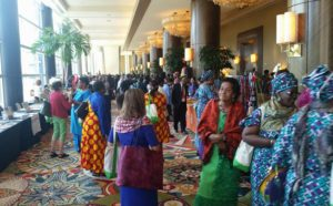 International vendors lined booths with free trade items, textiles, and jewelry.