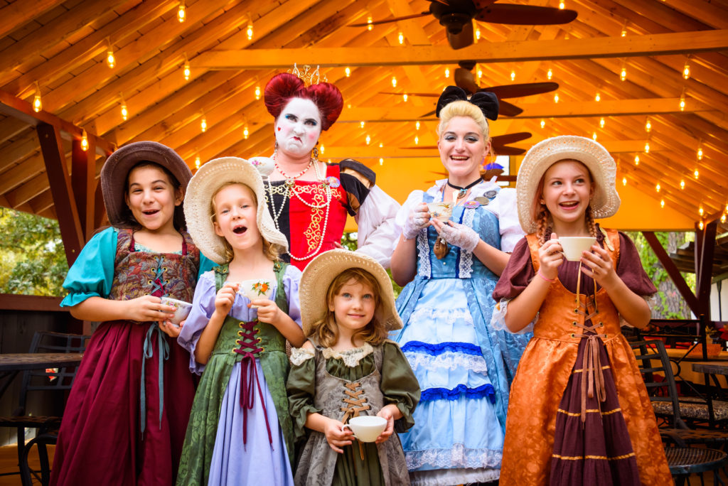Young girls in Renaissance costume with Alice and the Red Queen