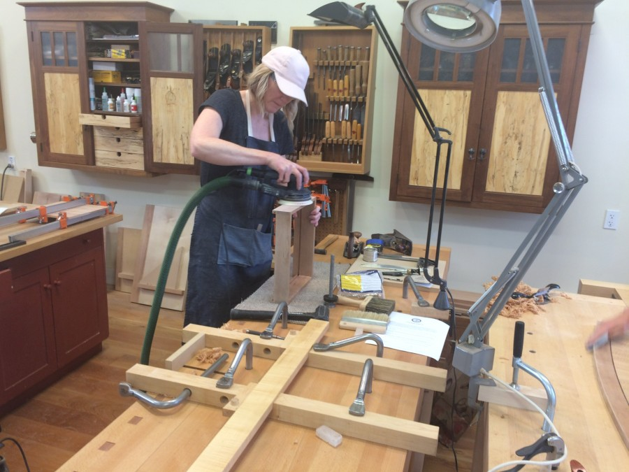 Carrie sanding the drawer for the bow-front sofa table.