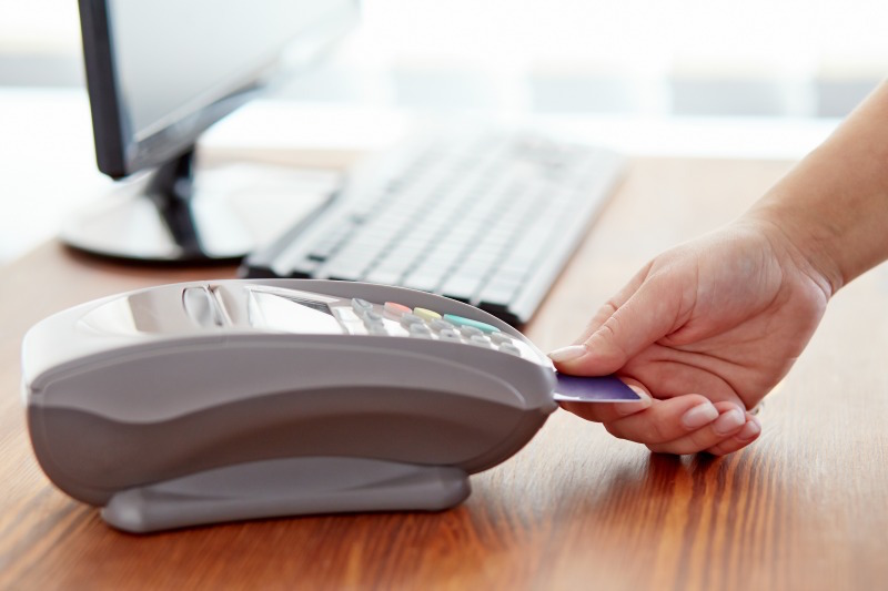Female hand controls payment terminal