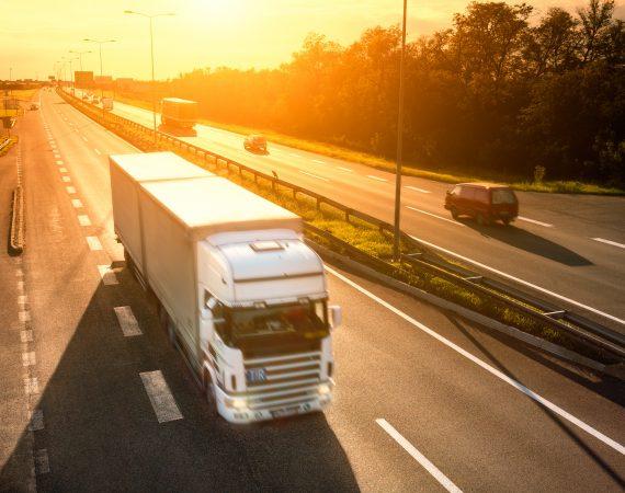 https://secureservercdn.net/166.62.110.60/s5x.80c.myftpupload.com/wp-content/uploads/2017/08/29382470_xxl-White-truck-in-motion-blur-on-the-highway-at-sunset-570x450.jpg