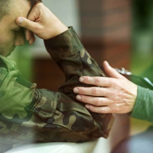 Psychiatrist comforting soldier with depression