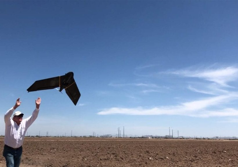 Rich Darling launches a drone for a surveying project in Arizona