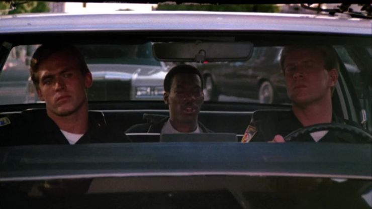 Axel Foley in a police car in Beverly Hills Cop
