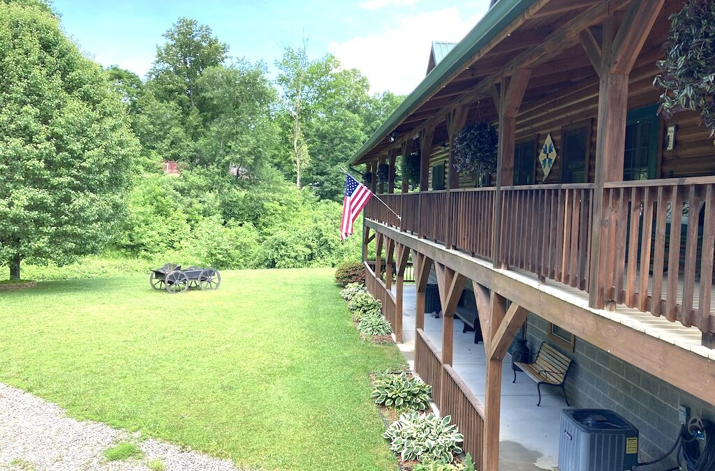 photo of two story covered porch and decking that runs the entire lenghth of the home